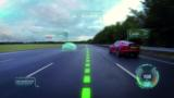 Jaguar's Virtual Windscreen aims to reduce driver distraction by filling the forward view with road-hazard alerts, navigation information and performance data.
