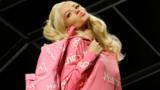 Moschino's blonde bombshells in candy pink hit the runway in Milan. It was a rare moment of humour among outright displays of power, writes Susie Lau.