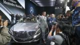 The world's executives and oligarchs have three new machines to covet, unveiled at the 2014 Los Angeles auto show.