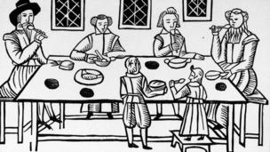 A 17th Century woodcut shows a Puritan family meal (Alamy)