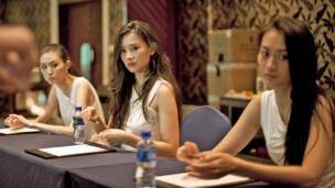 Miss China 2014 contestants learn etiquette from a Seatton instructor. (Darcy Holdorf)