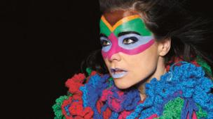 Drawings on Björk's face become a veil, and this mask adds a layer of content to her face
