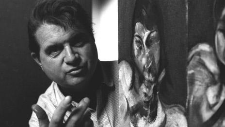 Francis Bacon with self-portrait (Corbis Images)