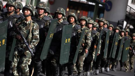 State security policing Urumqi in Xinjiang province during the 2009 riots. (Corbis)