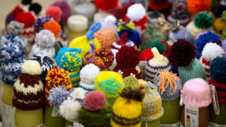 Knitted caps atop smoothies served to Davos attendees. (Johannes Eisele/AFP/Getty Images)