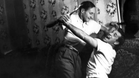 Burroughs and Jack Kerouac fighting in New York City in 1953. (Allen Ginsberg/Corbis)