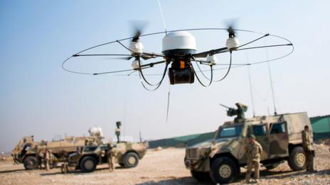 Drone flies in front of soldiers (Johannes Eisele/AFP/Getty Images)