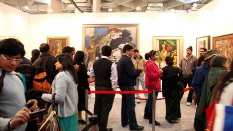 Visitors view works by MF Husain at New Delhi's Indian Art Summit. (EPA/Anindito/Corbis)