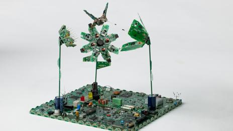 Flower artwork made from discarded circuit boards (E-Lab)