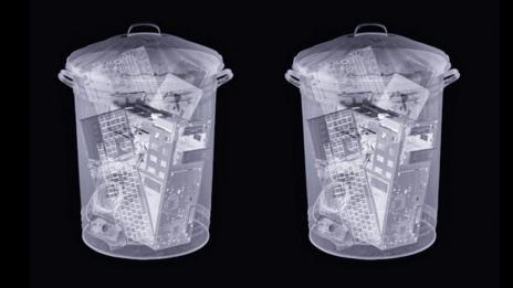 Electronics in bin (Science Photo Library)