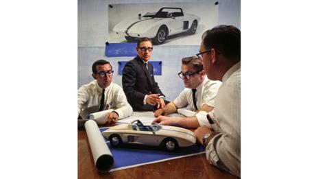 Executive Engineer Roy Lunn (center) and assistants study Ford Mustang 1 Model (Alamy)