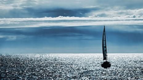 Boat on a vast ocean (Thinkstock)