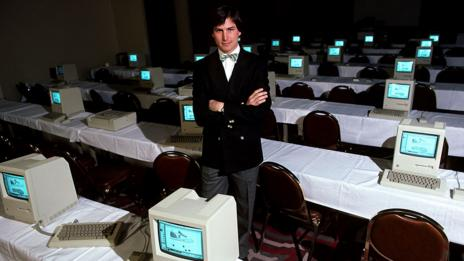 Steve Jobs with a room full of computers, 1984 (Getty Images)