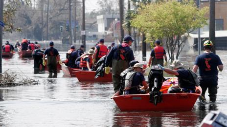 Rescue crews searching a New Orleans neighbourhood in 2005 (Getty Images)