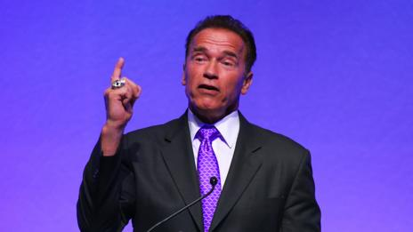 Arnold Schwarzenegger shows self confidence by wearing purple. (Getty Images)