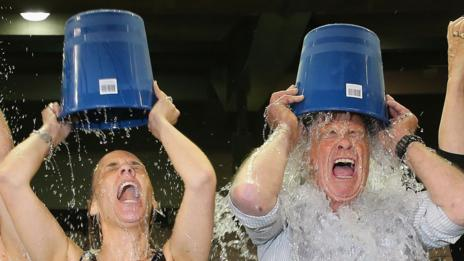 Is ice bucket about charity, or looking generous and game-for-a-laugh? (Getty Images)