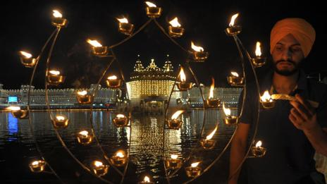 An Indian Sikh lights candles during Bandi Chhor Divas, or Diwali (Getty Images)