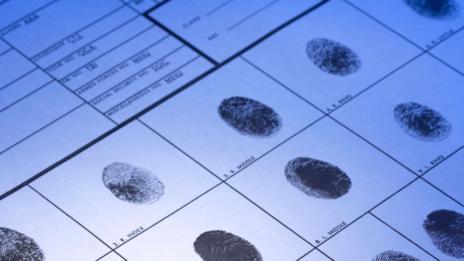 Fingerprints on a sheet of paper