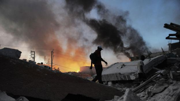 Man walks past flames in the aftermath of the Haiti Earthquake (Copyright: Getty Images)