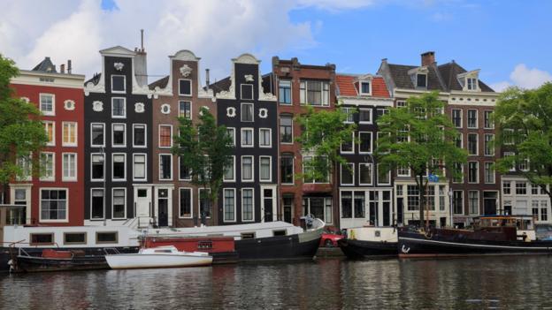 Houseboats, Amsterdam (Credit: Louise Heusinkveld/Getty)
