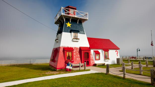 Acadian lighthouse (Credit: Barrett&MacKay/Getty)