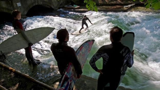 Eisbach river surfing (Credit: Peter Kneffel/AFP/Getty)