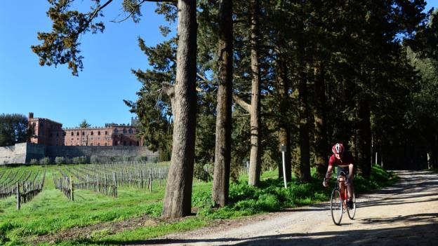 A cyclist rides past the castle of Brolio in Chianti (Credit: Giuseppe Cacace/AFP/Getty)