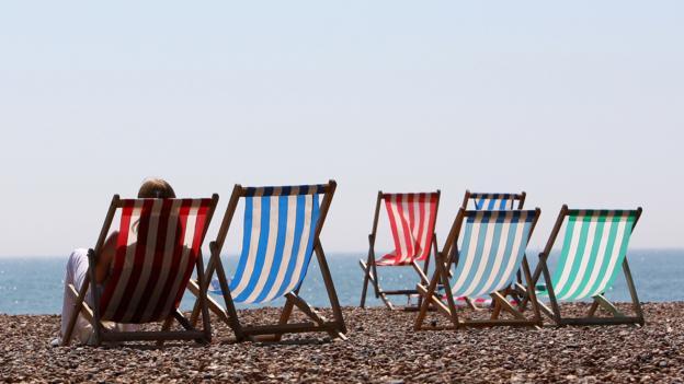 Deckchairs on Brighton beach (Credit: Getty Images)