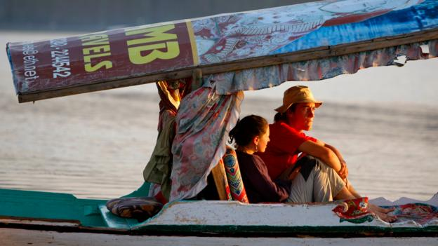 Tourists cruise along Dal Lake (Credit: Paula Bronstein/Getty)