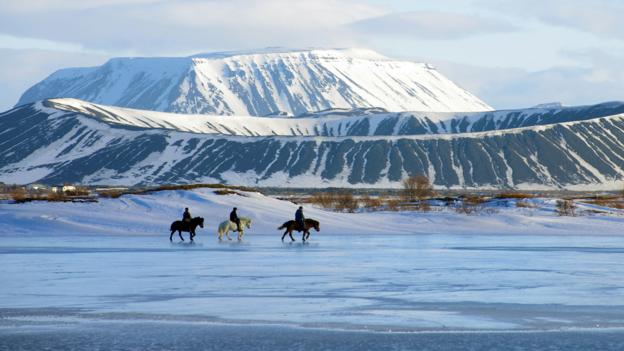 Horse riding on frozen Lake Myvatn (Credit: Reinhard Pantke/Getty)