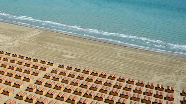 A beach on the Lido (Credit: Oliver Morin/AFP/Getty)