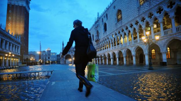 Platforms cover the flooded Piazza San Marco (Credit: Andrea Pattaro/AFP/Getty)