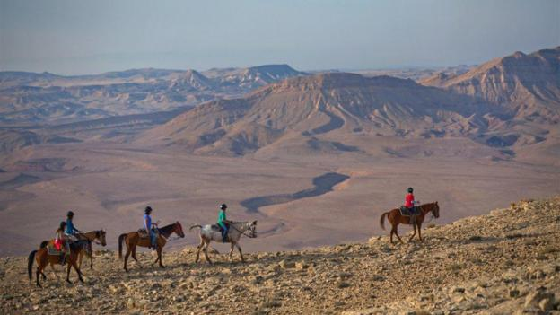 Horse riding in the crater (Credit: Dan Savery Raz)
