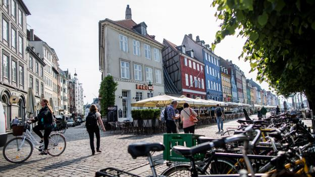 Cyclists and pedestrians on Nyhavn street (Credit: Dean Treml/Red Bull via Getty)