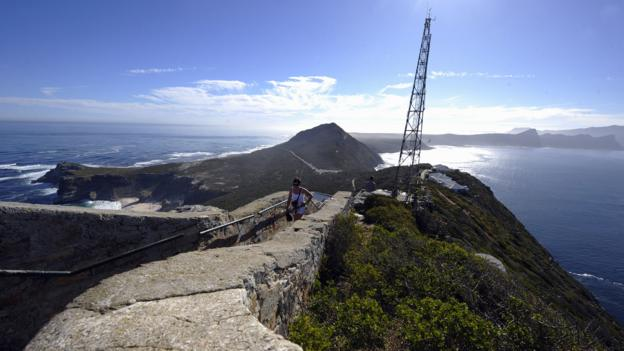 Tourists walk up to Cape Point (Credit: Gianluigi Guercia/AFP/Getty)