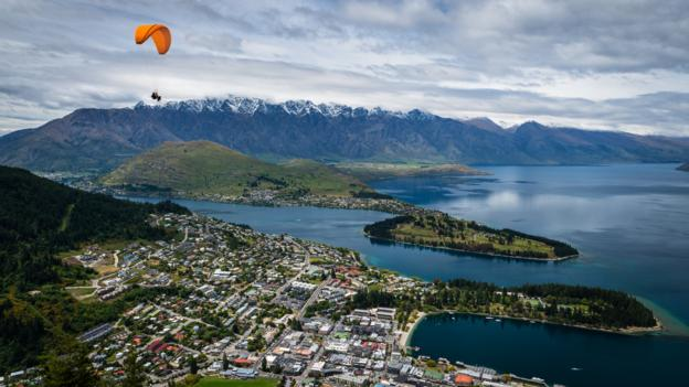 A parachute over Queenstown (Credit: NitiChuysakul Photography/Getty)