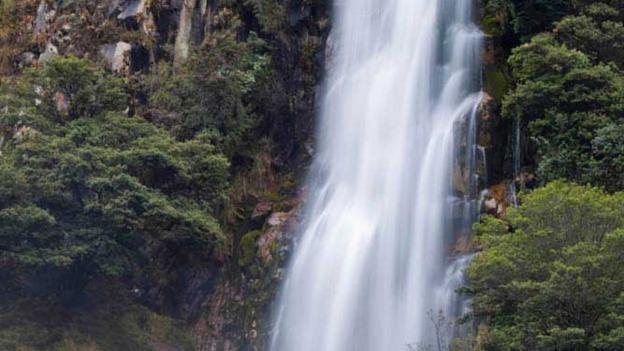 A waterfall along the Santa Cruz trek (Credit: Alex Robinson)