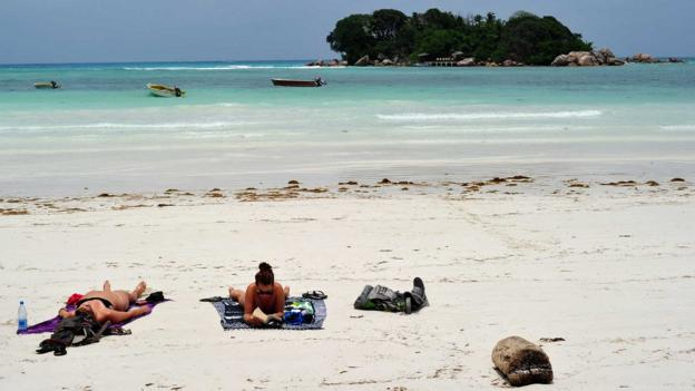 Tanning on Praslin Island (Credit: Alberto Pizzoli/AFP/Getty)