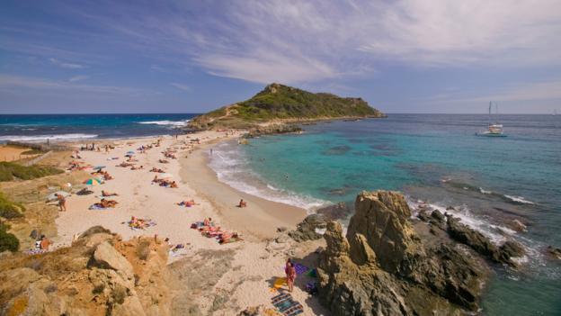 Sunbathers on Plage de la Briand, near St Tropez (Credit: Michael Melford/Getty)