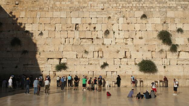 Jewish men pray at the Wailing Wall (Credit: Getty Images)