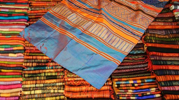 Textiles for sale at the night market in Luang Prabang (Credit: Grant Dixon/LPI/Getty)
