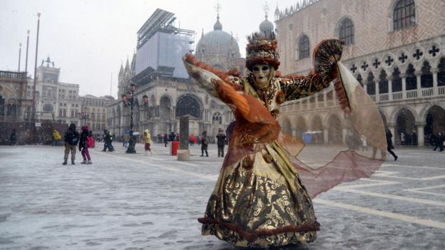A costumed reveller in the Piazza San Marco (Credit: AFP/Getty Images)