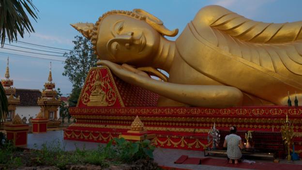 Reclining Buddha at monastery in Vientiane (Credit: Steve Golden/Getty)