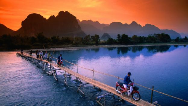Motorbike crossing in Vang Vieng (Credit: John Elk III/Getty)