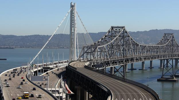The Bay Bridge connects Oakland to San Francisco (Credit: Getty)