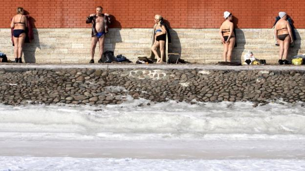 Sunbathing near the Peter and Paul Fortress (Credit: Elena Palm/AFP/Getty)