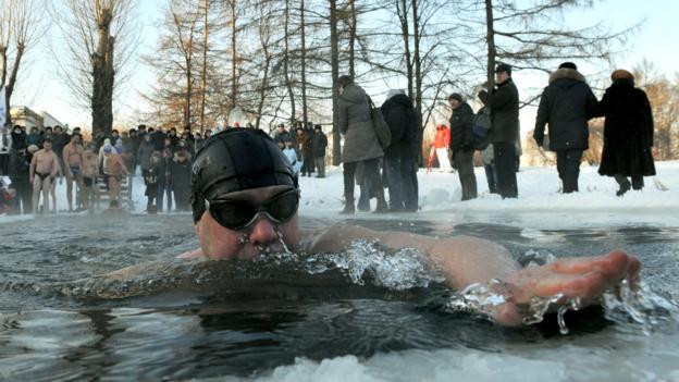 A man bathes in a Victory Park pond (Credit: Olga Maltseva/AFP/Getty)