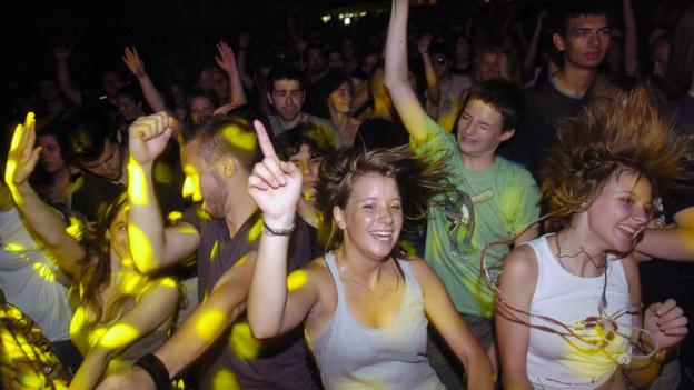 Dancing during an open air concert (Credit: STR/AFP/Getty)