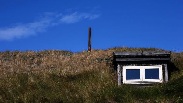 A grass-roof house on Mykines (Credit: Gavin Haines)