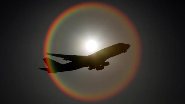 Plane surrounded by sun flare (Getty Images)